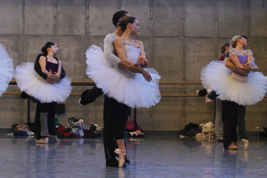 Tempe Ostergren and Lamin Pereira dos Santos rehearse 'Swan Lake,' flanked by other couples / Photo courtesy Kansas City Ballet